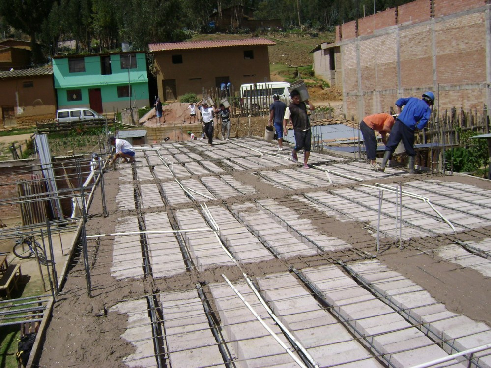 Pouring the cement for the ceiling of ground floor/floor of second story of the Church of God in Cajamarca, Peru. This building will serve the entire Cajamarca region for training church pastors, leaders, evangelists and church planters.